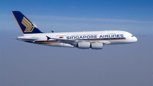 Nhà hàng A380 sẽ hoạt động trên một chiếc Airbus A380 đậu tại một cổng ở Sân bay Changi, Singapore. Nguồn ảnh: Singapore Airlines.