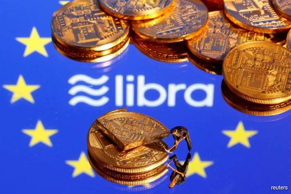 Các ngân hàng trung ương bắt đầu xem xét kỹ lưỡng các loại tiền kỹ thuật số sau khi Facebook vào năm ngoái công bố mã thông báo kỹ thuật số Libra sẽ được hỗ trợ bởi hỗn hợp các loại tiền tệ chính và nợ chính phủ. Nguồn ảnh: Reuters.