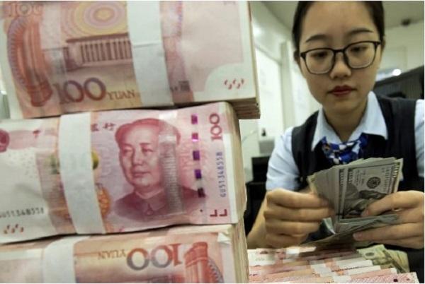 Vào tháng 5.2020, Viện Tài chính Quốc tế cho biết khoản nợ Trung Quốc vay phần còn lại của thế giới đã tăng lên hơn 6% GDP toàn cầu. Nguồn ảnh: AP.