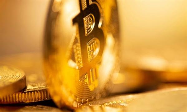 Trong năm 2020, giá trị của Bitcoin đã tăng khoảng 170%. Ảnh: Reuters.