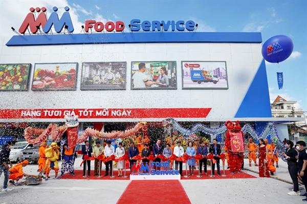 Lễ cắt băng khai trương Trung tâm phân phối và bán sỉ thực phẩm – trung tâm MM Food Service Hưng Phú.