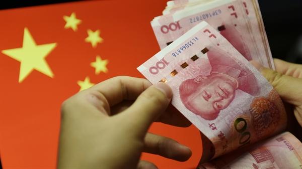 Các nhà đầu tư toàn cầu theo đuổi lợi nhuận cao gần đây đã đổ tiền vào trái phiếu chính phủ Trung Quốc với tốc độ kỷ lục. Ảnh: AP.
