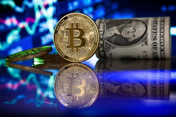 Các nhà đầu cơ, thủ quỹ công ty và các nhà đầu tư tổ chức được cho là đã thúc đẩy sự phát triển của Bitcoin. Ảnh: EPA.