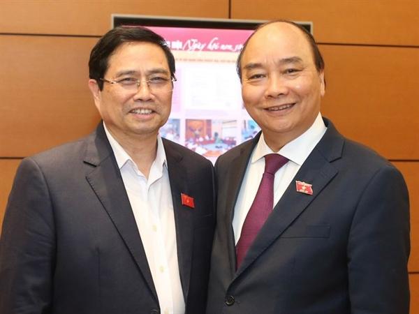 Tân Thủ tướng Phạm Đình Chính bên cạnh Tân Ảnh: