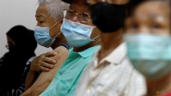 Mọi người chờ tiêm chủng tại một trung tâm chủng ngừa vaccine COVID-19 ở Singapore vào ngày 8 tháng 3 năm 2021. Ảnh: Reuters.