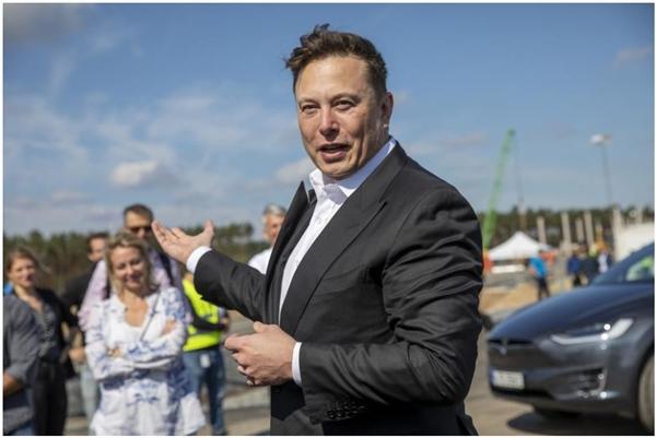 CEO Tesla Elon Musk đã áp dụng dogecoin, ngay cả sau khi mua thêm số bitcoin trị giá 1,5 tỉ USD vào bảng cân đối kế toán của Tesla hồi đầu năm nay. Ảnh: Getty Images.